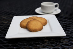 Butter cookies with espresso on patio table Royalty Free Stock Photo