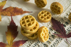 Butter cookies fluted. The composition of the pyramid of corrugated biscuit cookies and autumn leaves Royalty Free Stock Photos