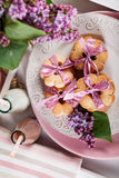 Butter cookies with pink ribbon,lilac flowers and chocolate milk Royalty Free Stock Image