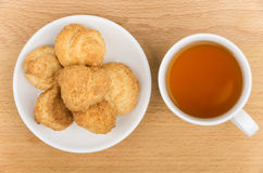 Butter cookies in white saucer and tea Stock Photography