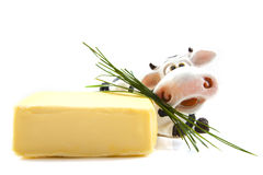 Butter cow. Butter with cow and grass isolated over white Royalty Free Stock Photos