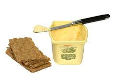 Butter and crackers. Isolated on pure white background Stock Photo