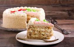 Butter cream decorated cake. On grey  table Stock Photo