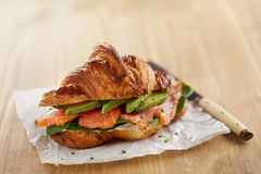 Butter croissant with avocado and salmon Royalty Free Stock Image