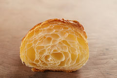 Butter croissant interior close-up on wooden table Royalty Free Stock Photo