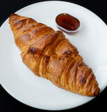 Butter croissant. With jam on white dish Royalty Free Stock Photography