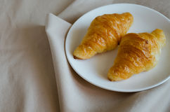 Butter Croissant On White Ceramic Dish. Butter croissant on white ceramic dish for breakfast Royalty Free Stock Photography