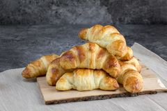 Butter croissants on natural wood plank royalty free stock images