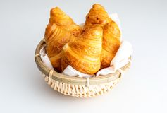 Butter croissants in small wicker basket. Aerial top view on c royalty free stock image