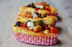 Butter cupcake topping dries fruit and peanut on wooden board Royalty Free Stock Photo