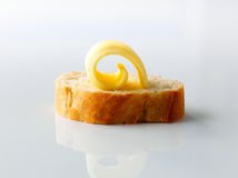 Butter curl on bread Royalty Free Stock Image