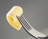 Butter curl on a fork Royalty Free Stock Photo
