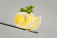 Butter curl on a knife stock images