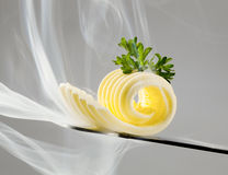 Butter curl on a knife Stock Photography