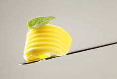 Butter curl on a knife royalty free stock photo