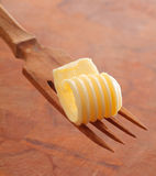 Butter curl on a wooden fork Stock Image