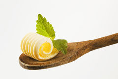 Butter curl on a wooden spoon Royalty Free Stock Photo