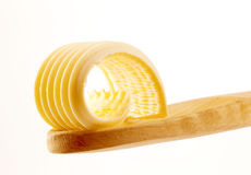 Butter curl on a wooden spoon Royalty Free Stock Image