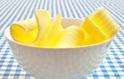 Butter curls. Several butter curls in a bowl Stock Photo