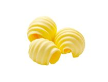 Butter curls. Curls of fresh butter isolated on white royalty free stock photo