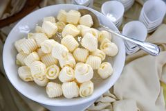 Butter curls in a white bowl Royalty Free Stock Photography