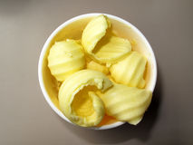 Butter curls. Yellow butter curls in a dish ready to be used Stock Images