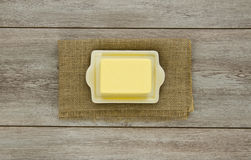 Butter on dish with burlap Stock Images