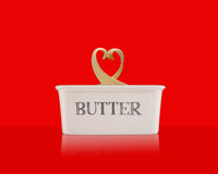 Butter dish with heart shaped butter curl Stock Photos