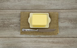 Butter on dish with knife Royalty Free Stock Photography