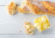 Butter and fresh crunchy homemade bread. Healthy organic breakfast on rustic white wooden table royalty free stock images