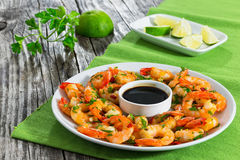 Butter garlic fried shrimps sprinkled with pieces of chilli Royalty Free Stock Photography