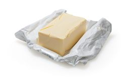 Butter getrennt auf Weiß Stockfotografie