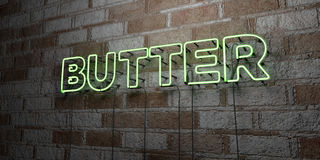 BUTTER - Glowing Neon Sign on stonework wall - 3D rendered royalty free stock illustration Stock Images