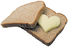 Butter heart melting. Butter heart melts in between two slices of bread Royalty Free Stock Images