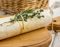 Butter with herbs in parchment paper folded Royalty Free Stock Photos