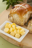 Butter And Hot Cross Buns Stock Photography