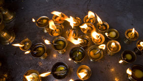 Butter lamps burning in a temple kathmandu Stock Photo