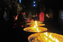 Butter lamps with flames Stock Photos