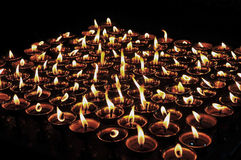 Butter lamps with flames Stock Photography