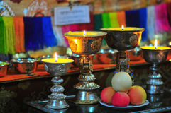 Butter lamps with flames Royalty Free Stock Image