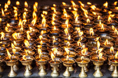 Butter lamps with flames Royalty Free Stock Images