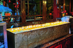 Butter lamps with flames. Near Bodhnath stupa in Sat kya Monastery of Sat kya Sect, Tibetan buddhism, lhasa Stock Photos