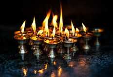 Butter lamps with flames Royalty Free Stock Photography