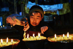 Butter lamps and Tibetan famale Stock Photo