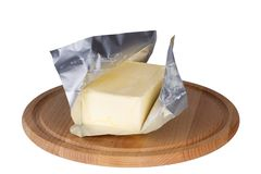 Butter lokalisiert auf einem weißen Hintergrund Lizenzfreie Stockfotos