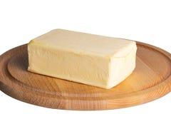Butter lokalisiert auf einem weißen Hintergrund Stockbilder