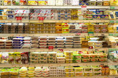 Butter and Margarine. Refrigerated shelves of butter and margarine at the supermarket. Photo was taken on 10 February 2013 Royalty Free Stock Photos