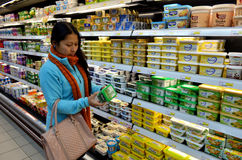 Butter & Margarine. Young woman choosing Butter and margarine  in a supermarket. Image taken on the 10th of December 2013 in Intermarche supermarket in the Royalty Free Stock Image