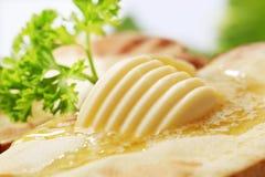 Butter melting on baked potato Royalty Free Stock Image