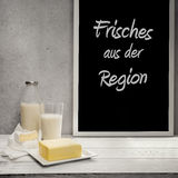 Butter,Milk and Camembert cheese on sideboard with blackboard Royalty Free Stock Images